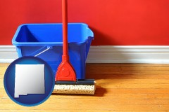 new-mexico a bucket and mop on a hardwood floor