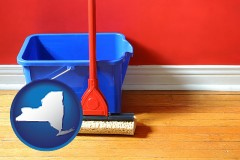 new-york map icon and a bucket and mop on a hardwood floor