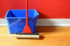 a bucket and mop on a hardwood floor