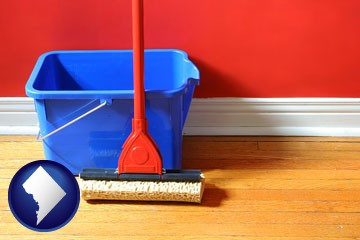 a bucket and mop on a hardwood floor - with Washington, DC icon