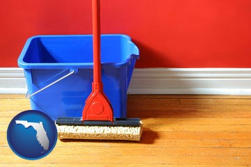 a bucket and mop on a hardwood floor - with Florida icon