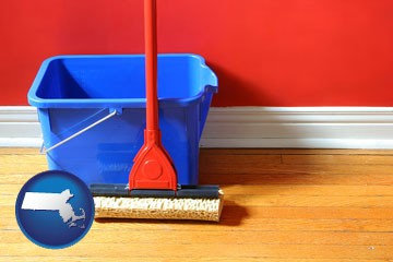 a bucket and mop on a hardwood floor - with Massachusetts icon
