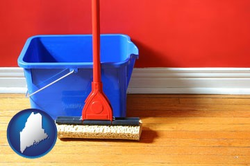 a bucket and mop on a hardwood floor - with Maine icon