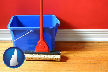 a bucket and mop on a hardwood floor - with New Hampshire icon