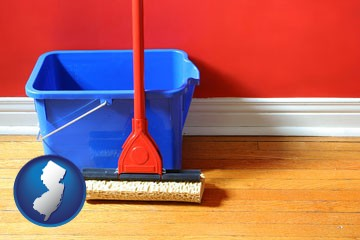 a bucket and mop on a hardwood floor - with New Jersey icon