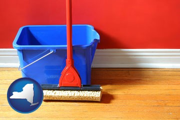 a bucket and mop on a hardwood floor - with New York icon
