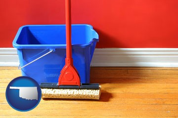 a bucket and mop on a hardwood floor - with Oklahoma icon