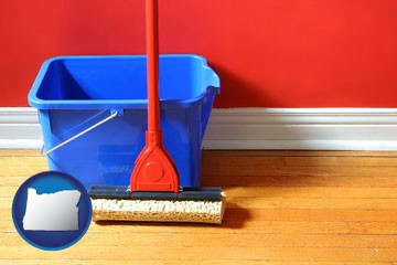 a bucket and mop on a hardwood floor - with Oregon icon