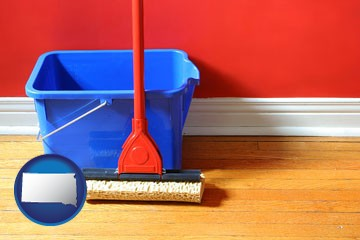 a bucket and mop on a hardwood floor - with South Dakota icon