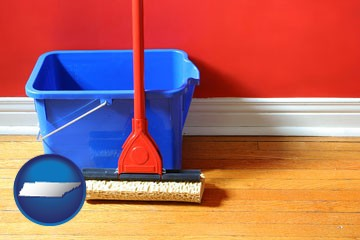 a bucket and mop on a hardwood floor - with Tennessee icon