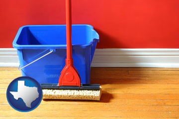 a bucket and mop on a hardwood floor - with Texas icon