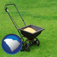 south-carolina map icon and a lawn fertilizer spreader