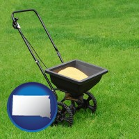 south-dakota map icon and a lawn fertilizer spreader
