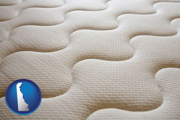 a mattress surface - with Delaware icon