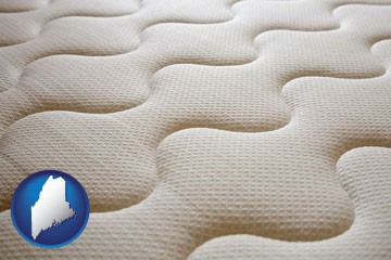 a mattress surface - with Maine icon