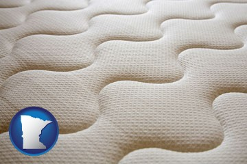 a mattress surface - with Minnesota icon