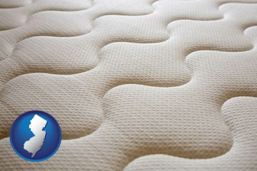 a mattress surface - with New Jersey icon