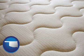 a mattress surface - with Oklahoma icon