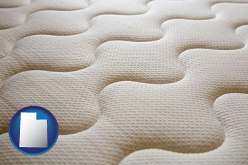 a mattress surface - with Utah icon