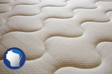a mattress surface - with Wisconsin icon