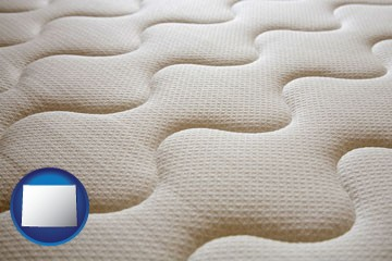 a mattress surface - with Wyoming icon