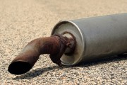 a rusty muffler and tailpipe