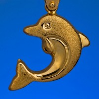a gold dolphin pendant