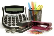 office supplies: calculator, paper clips, pens, scissors, stapler, and staples