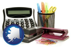 alaska map icon and office supplies: calculator, paper clips, pens, scissors, stapler, and staples