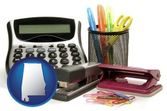 alabama map icon and office supplies: calculator, paper clips, pens, scissors, stapler, and staples