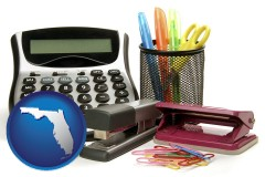 florida map icon and office supplies: calculator, paper clips, pens, scissors, stapler, and staples