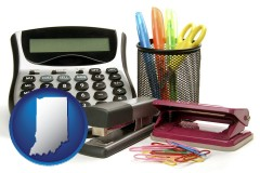 indiana map icon and office supplies: calculator, paper clips, pens, scissors, stapler, and staples