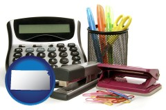 kansas map icon and office supplies: calculator, paper clips, pens, scissors, stapler, and staples