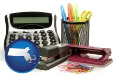 massachusetts map icon and office supplies: calculator, paper clips, pens, scissors, stapler, and staples