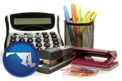 maryland map icon and office supplies: calculator, paper clips, pens, scissors, stapler, and staples