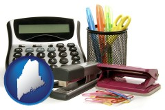 maine map icon and office supplies: calculator, paper clips, pens, scissors, stapler, and staples
