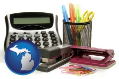 michigan office supplies: calculator, paper clips, pens, scissors, stapler, and staples