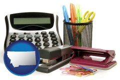 montana map icon and office supplies: calculator, paper clips, pens, scissors, stapler, and staples