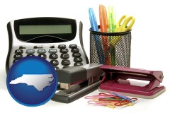 north-carolina map icon and office supplies: calculator, paper clips, pens, scissors, stapler, and staples