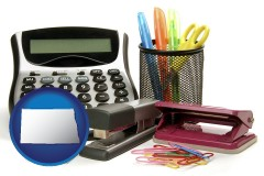 north-dakota office supplies: calculator, paper clips, pens, scissors, stapler, and staples
