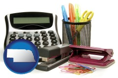 nebraska office supplies: calculator, paper clips, pens, scissors, stapler, and staples
