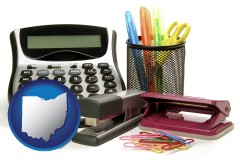 ohio map icon and office supplies: calculator, paper clips, pens, scissors, stapler, and staples