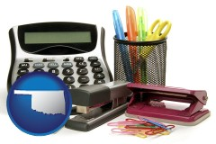 oklahoma office supplies: calculator, paper clips, pens, scissors, stapler, and staples