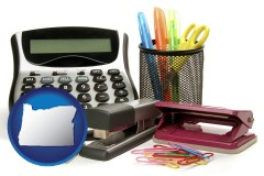 oregon map icon and office supplies: calculator, paper clips, pens, scissors, stapler, and staples