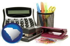 south-carolina map icon and office supplies: calculator, paper clips, pens, scissors, stapler, and staples