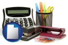 utah map icon and office supplies: calculator, paper clips, pens, scissors, stapler, and staples