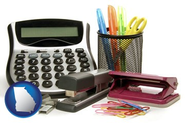 office supplies: calculator, paper clips, pens, scissors, stapler, and staples - with Georgia icon
