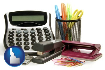 office supplies: calculator, paper clips, pens, scissors, stapler, and staples - with Idaho icon