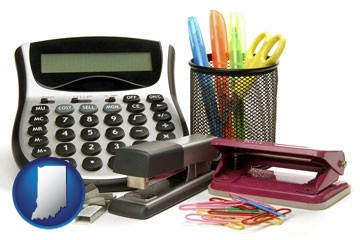 office supplies: calculator, paper clips, pens, scissors, stapler, and staples - with Indiana icon