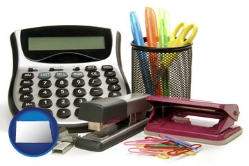office supplies: calculator, paper clips, pens, scissors, stapler, and staples - with North Dakota icon